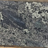 Pyrite and pyrrhotite in altered volcanic at 122m